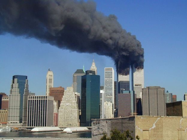 Plumes of smoke billow from the World Trade Center towers in Lower Manhattan, New York City, after a Boeing 767 hits each tower during the September 11 attacks.
