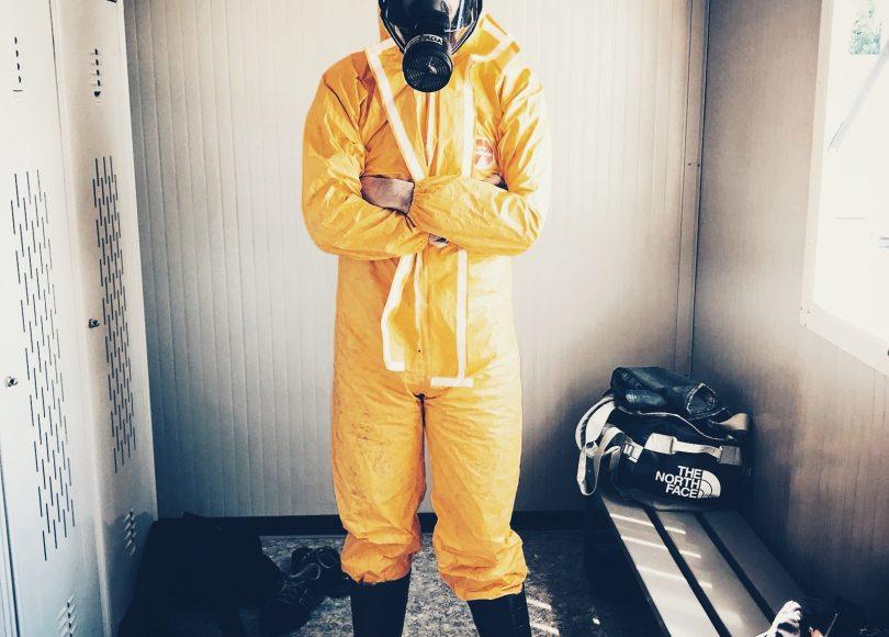 Pexels - Man in a yellow hazmat suit.