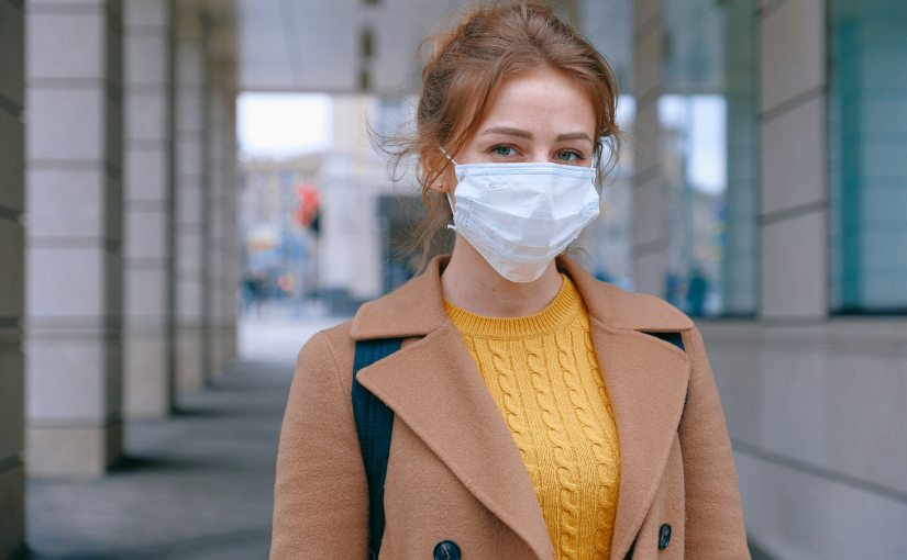 Pexels - A woman wearing a face mask