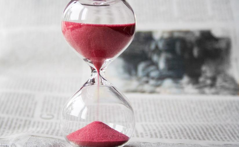 Pexels - An hourglass with red sand running down.