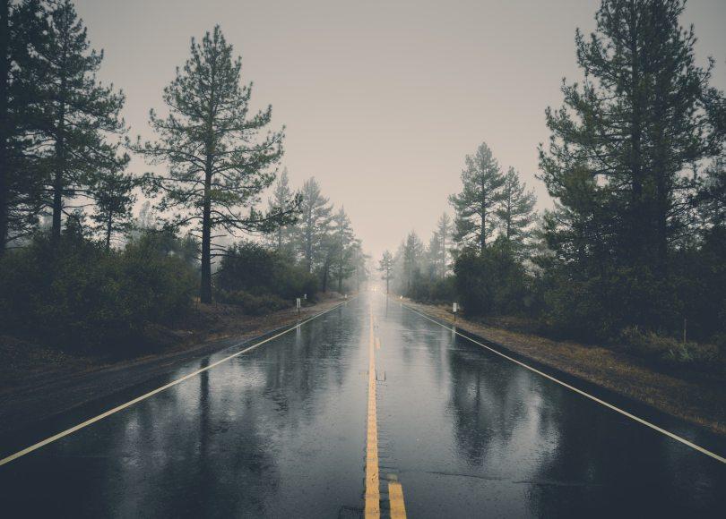 Pexels - Rain on an empty, foggy highway.