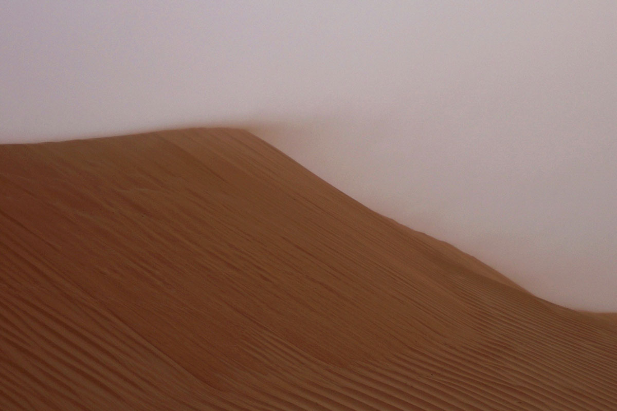 Pexels - Wind blowing across a large sand dune