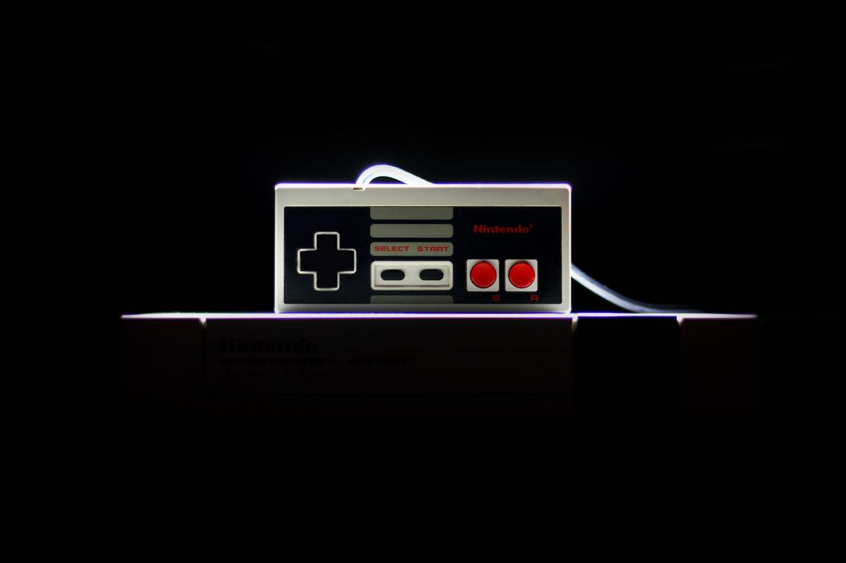 Pexels - Tomasz Filipek - Nintendo game controller on black background