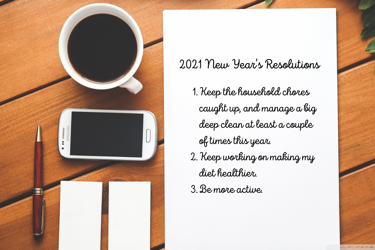 2021 New Year's Resolutions - A cup of coffee, a phone, a pen, and a piece of paper sitting on a desk. New Year's resolutions are written on the paper.