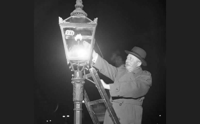 A lamplighter lighting a gas streetlight in Sweden, 1953. By this time, remaining gas lamps were rare curiosities. Gunnar Lanz, Stockholms stadsmuseum.