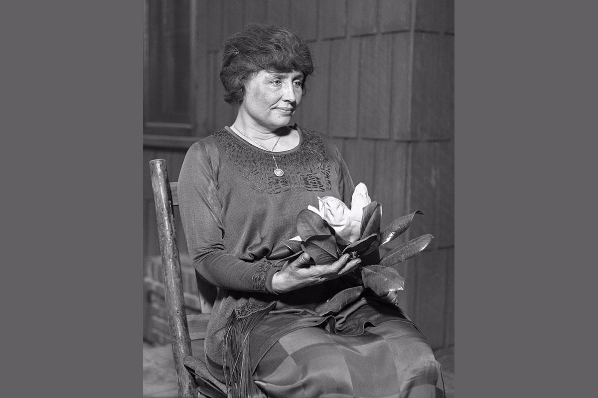 Keller holding a magnolia, c.1920