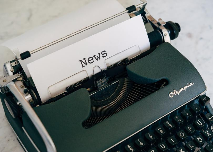 Pexels - Markus Winkler - Typewriter with a sheet of paper rolled up that reads 'News.'